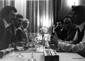 Guy is in foreground left, John S across the table, Jim P in left rear.