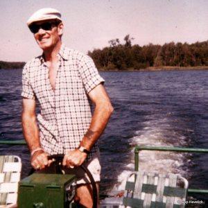 Jim driving Bob Stead's pontoon - about 1971