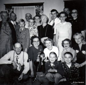 Jim and his mother are in the back row, far right. Einar is in the back row, framed by the window.