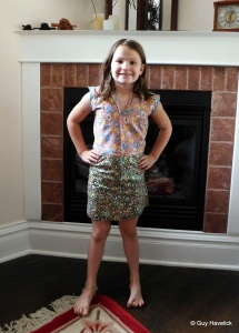 Audrey wearing the dress sewn by her great grand mother Grace.