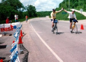 Guy and Lon crossing the finish line after a Zumbro Zig Zag
